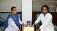 Tej Pratap Yadav receives RJD symbol from mother Rabri Devi