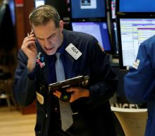 Wall St sunk by corporate cost warnings, bond nerves