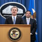 US charges 8 in alleged Chinese surveillance effort in US