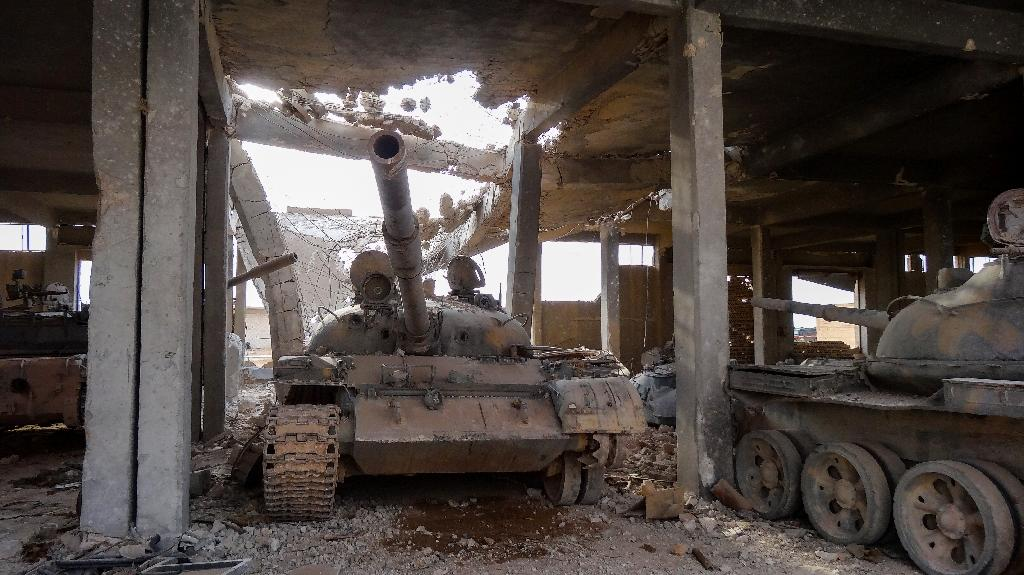 A warehouse in the town of Uqayribat, part of eastern Hama province recaptured by the army from the Islamic State group was used by the jihadists to refit tanks as attack vehicles for suicide bombers (AFP Photo/Maria ANTONOVA)