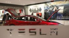 Stocks - Tesla Volatile in Pre-market; Dropbox, News Corp Sink; ExOne Plummets