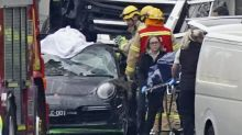 Four police killed by truck after stopping speeding Porsche driver
