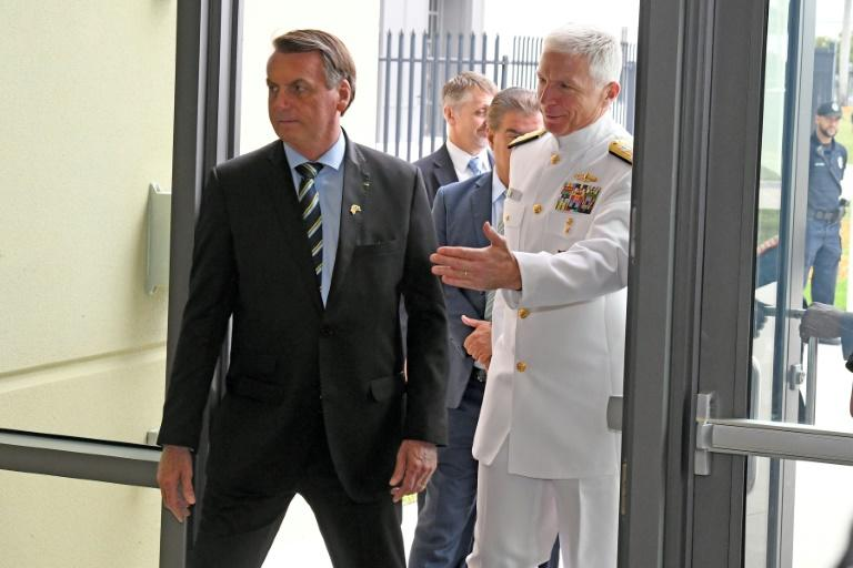 Brazilian President Jair Bolsonaro(C), is greeted by Commander, US Southern Command Admiral Craig Faller(R) in Miami, Florida on March 8, 2020; Brazil's leader was there to discuss growing bilateral defense-cooperation partnership