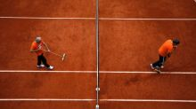 First man on court, French Open manager keeps the clay in shape