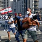 Beirut explosions: Lebanon's prime minister calls for early elections as over 110 wounded in protests
