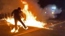 Shocking moment protester catches fire during chaotic night