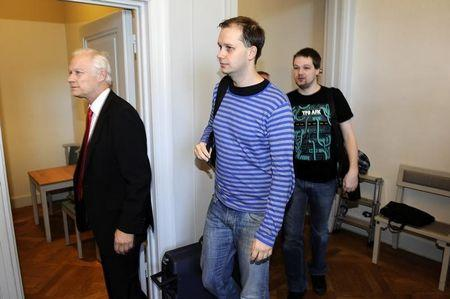 Fredrik Neij and Peter Sunde, two co-founders of the file-sharing website, The Pirate Bay, arrive at the Swedish Appeal Court in Stockholm