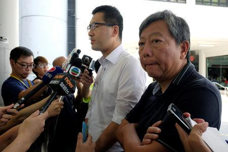 FILE PHOTO: Pro-democracy lawmaker Lam Cheuk-ting (L) and Democratic Party member Lee Cheuk-yan meet journalists outside a hospital in Hong Kong, China August 11, 2017. REUTERS/Bobby Yip/File Photo
