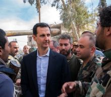Syria's Assad visits troops in battle-scarred Ghouta