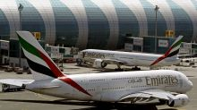 The Latest: Royal Jordanian to enforce ban starting Friday