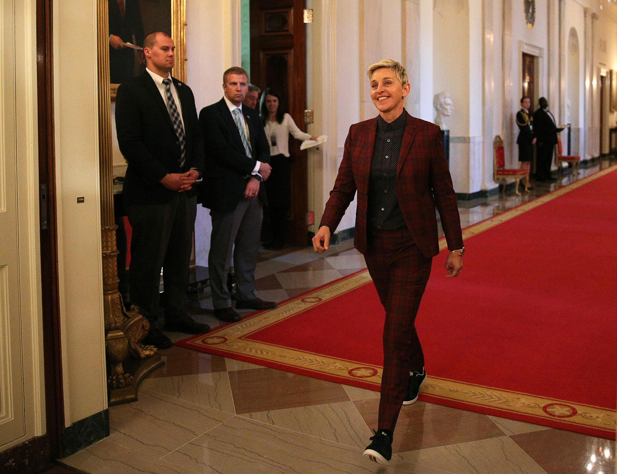 <p>Comedian Ellen DeGeneres heads to her seat before a ceremony awarding the Presidential Medal of Freedom to various recipients in the East Room of the White House in Washington, U.S., Nov. 22, 2016. (Carlos Barria/Reuters) </p>