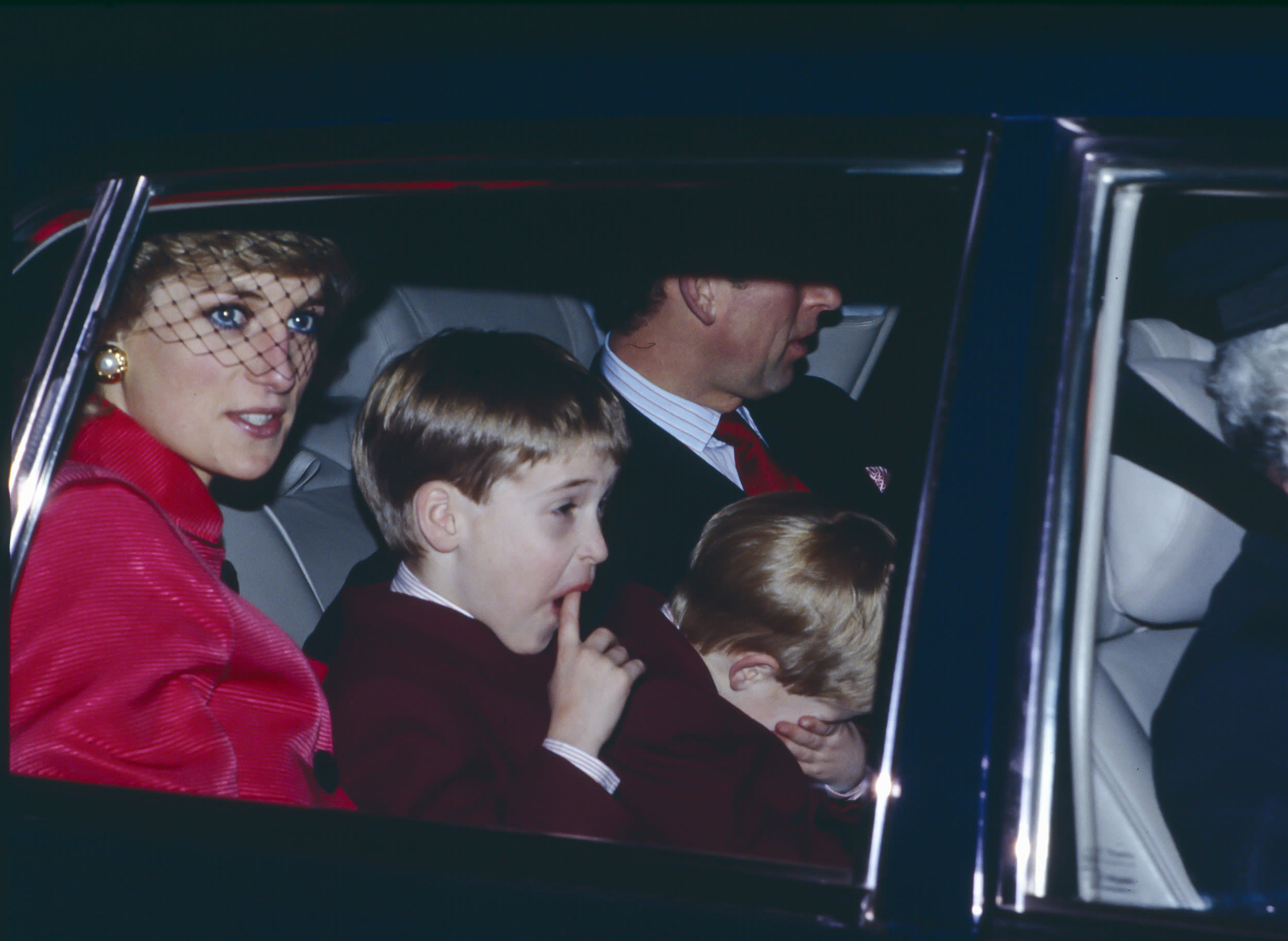 LONDON,  UNITED KINGDOM - DECEMBER 20:   Diana, Princess of Wales, Charles, Prince of Wales, Prince William, and Prince Harry attend the Christening of Princess Beatrice, at St James Palace,  on December 20, 1988  in London, United Kingdom. (Photo by Julian Parker/UK Press via Getty Images)