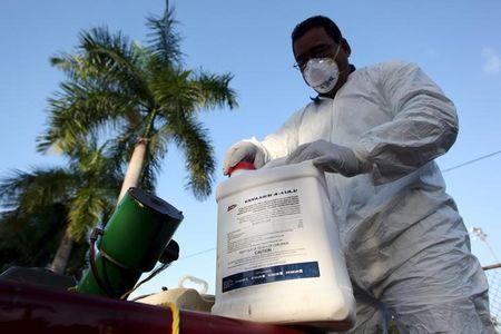A health worker prepares insecticide before fumigating a neighborhood in San Juan, in this January 27, 2016, file photo. REUTERS/Alvin Baez/Files