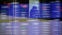 Asia stocks rise as U.S. earnings prop up Wall St., dollar solid