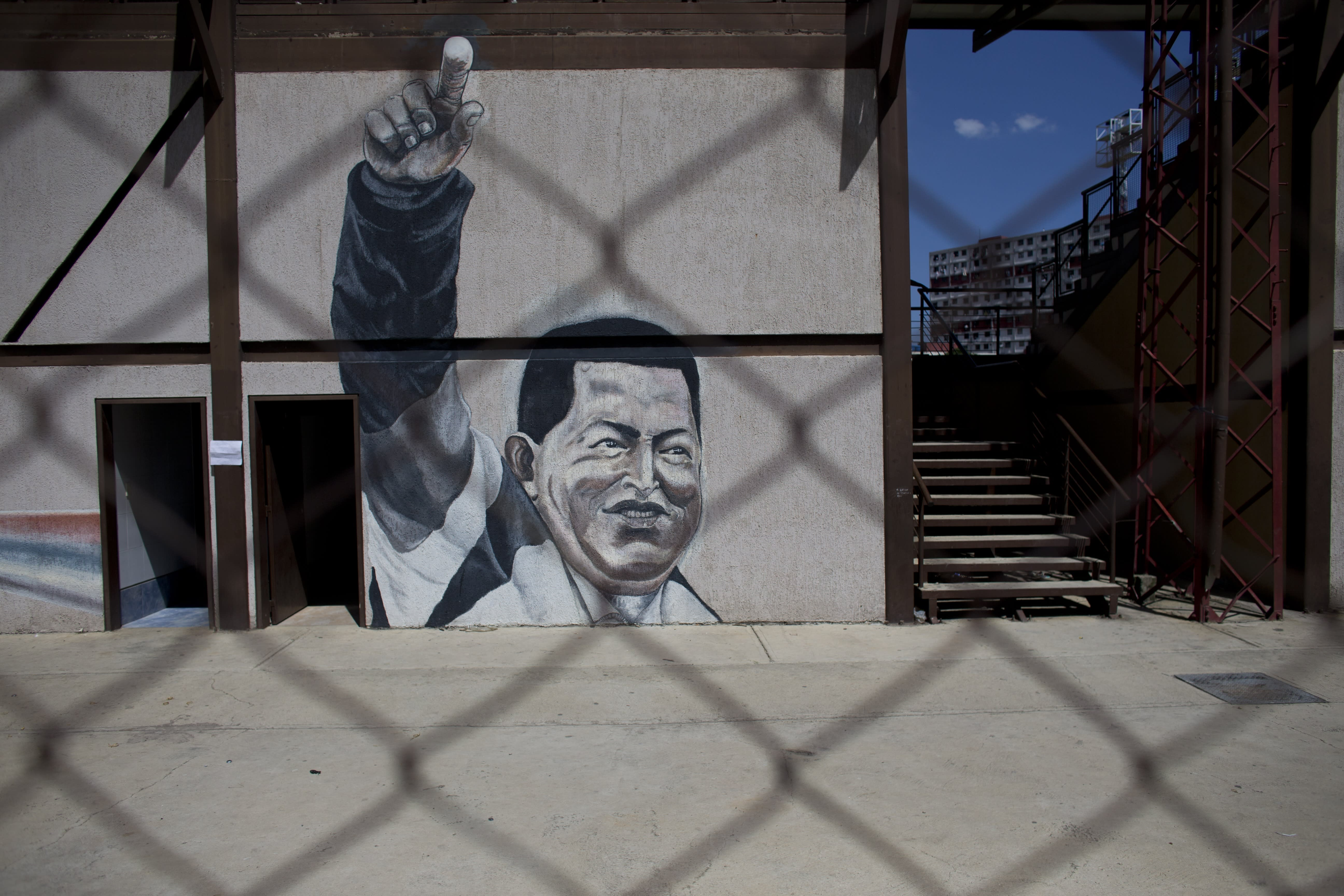 """A mural of Venezuela's late President Hugo Chavez decorates a wall in the """"23 de Enero"""" neighborhood of Caracas, Venezuela, Sunday, July 28, 2019, on his birthday anniversary. Venezuelans are paying homage to Chávez on the day of his birth, which happens to coincide with the birthday of one of the nation's leading opposition figures, Juan Guaidó. (AP Photo/Ariana Cubillos)"""