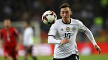Arsenal star Ozil misses training with back injury