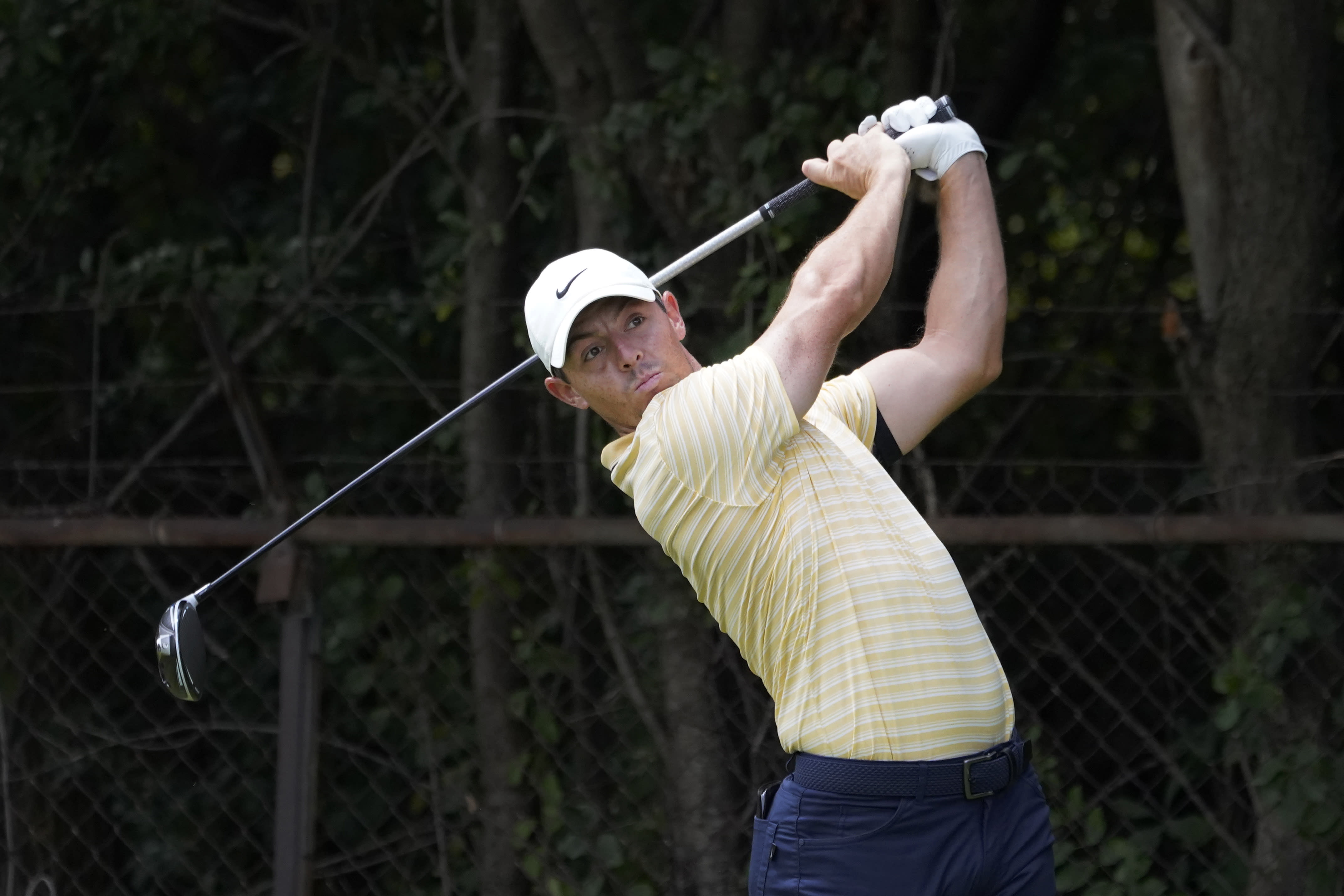 Rory McIlroy, of Northern Ireland, watches his tee shot on the second hole during the third round Saturday, Aug. 29, 2020, for the BMW Championship golf tournament at the Olympia Fields Country Club in Olympia Fields, Ill. (AP Photo/Charles Rex Arbogast)