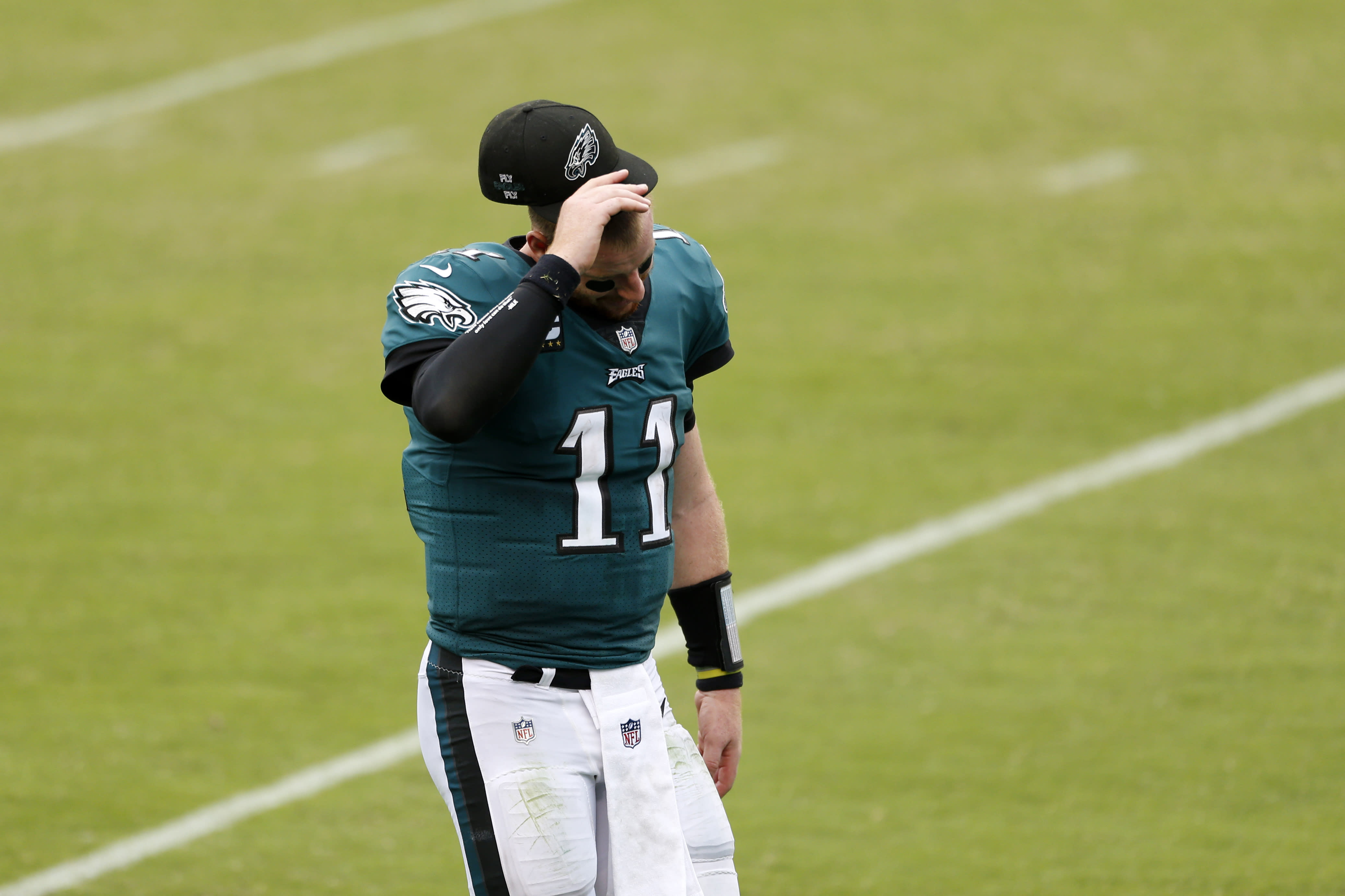 Philadelphia Eagles' Carson Wentz walks off the field after an NFL football game against the Cincinnati Bengals, Sunday, Sept. 27, 2020, in Philadelphia. (AP Photo/Laurence Kesterson)