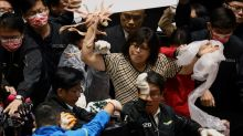 Fists and pig guts fly in Taiwan parliament debate on U.S. pork