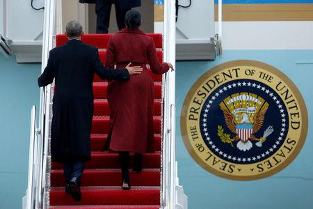 Former president Barack Obama and his wife Michelle board Special Air Mission 28000, a Boeing 747 which serves as Air Force One, at Joint Base Andrews, Maryland