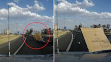 'Buy a lotto ticket': Horrifying moment car hit by ping pong table at 100km/h