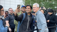 Apple CEO Tim Cook pet dogs, shook hands, and took selfies at Fifth Avenue re-opening