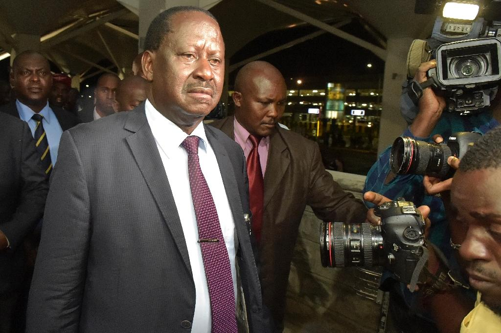 Kenya's opposition leader Raila Odinga arrives at Jomo Kenyatta airport in Nairobi March 27, 2018, as he attempts to step in to have Kenyan-born Canadian lawyer and self-declared National Resistance Movement General Miguna Miguna allowed entry (AFP Photo/SIMON MAINA)