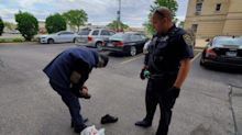 Police officer gives homeless man shoes off his own feet