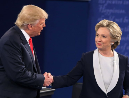 Hillary Clinton and Donald Trump shake hands after the second presidential debate at Washington University in St. Louis, Mo., on Oct. 9, 2016.
