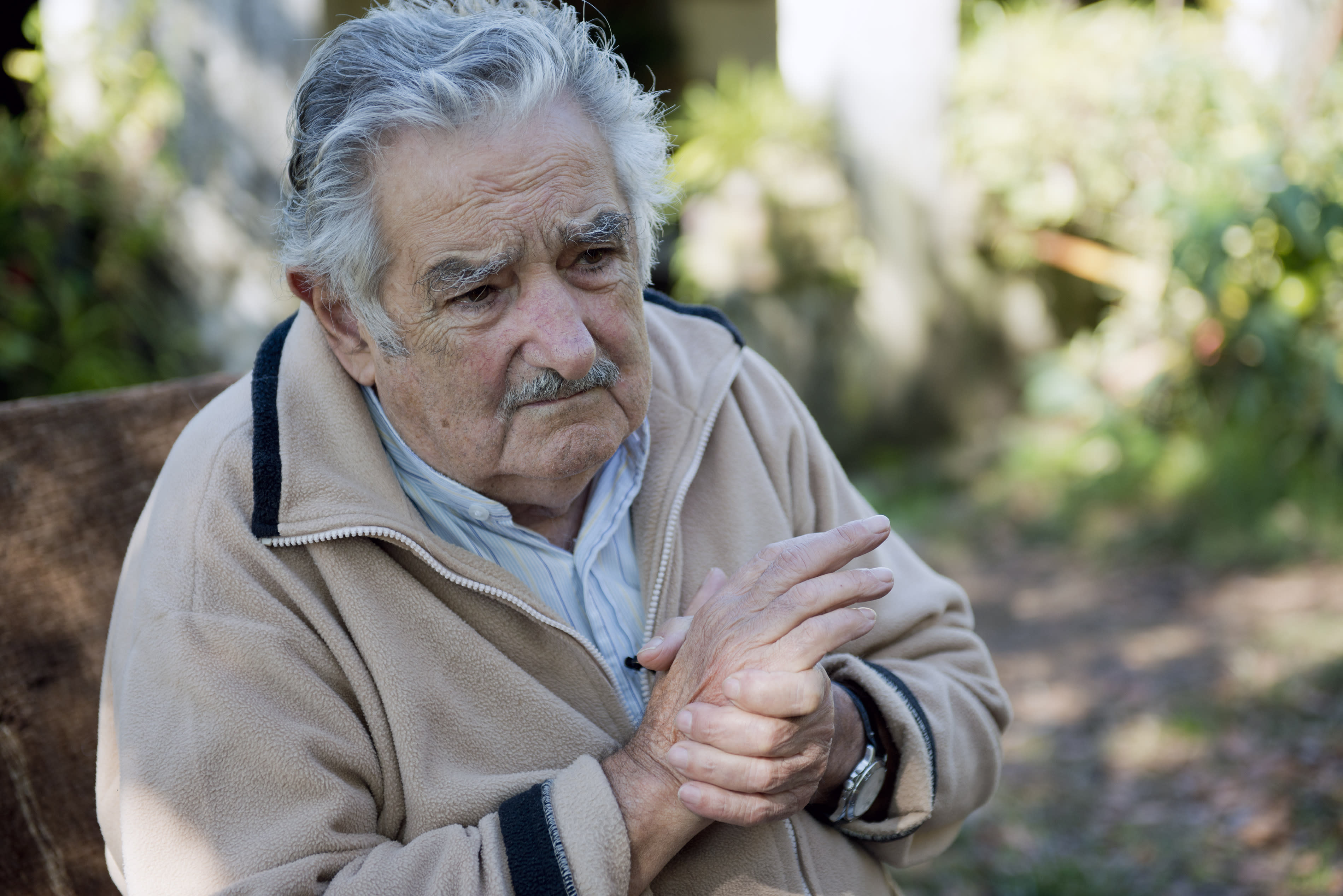 """Uruguay's President Jose Mujica pauses during an interview at his home on the outskirts of Montevideo, Uruguay, Friday, May 2, 2014. Mujica says the country's legal marijuana market will be much less permissive with drug users. """"We don't go along with the idea that marijuana is benign, poetic and surrounded by virtues. No addiction is good,"""" he said. In an exclusive Associated Press interview just before releasing his country's long-awaited marijuana rules, the former leftist guerrilla predicted that many will call him an """"old reactionary"""" once they see the fine print. (AP Photo/Matilde Campodonico)"""