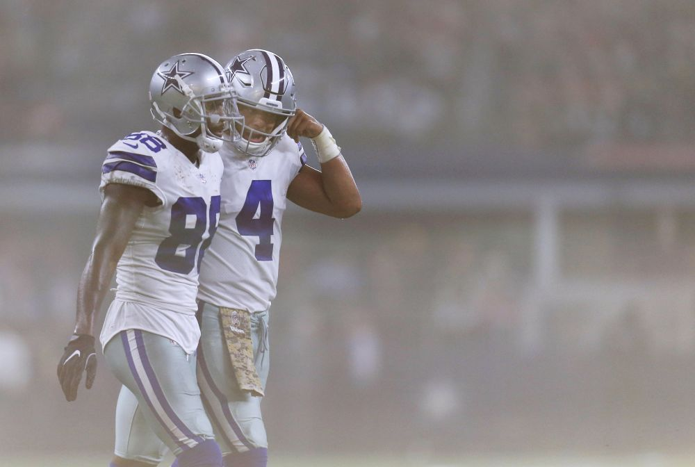Dak Prescott (R) and Dez Bryant haven't been able to forge a dynamic offensive duo this season. (AP)