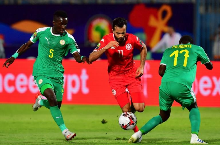 Tunisia star Taha Yassine Khenissi (C) playing against Senegal in a 2019 Africa Cup of Nations semi-final in Egypt