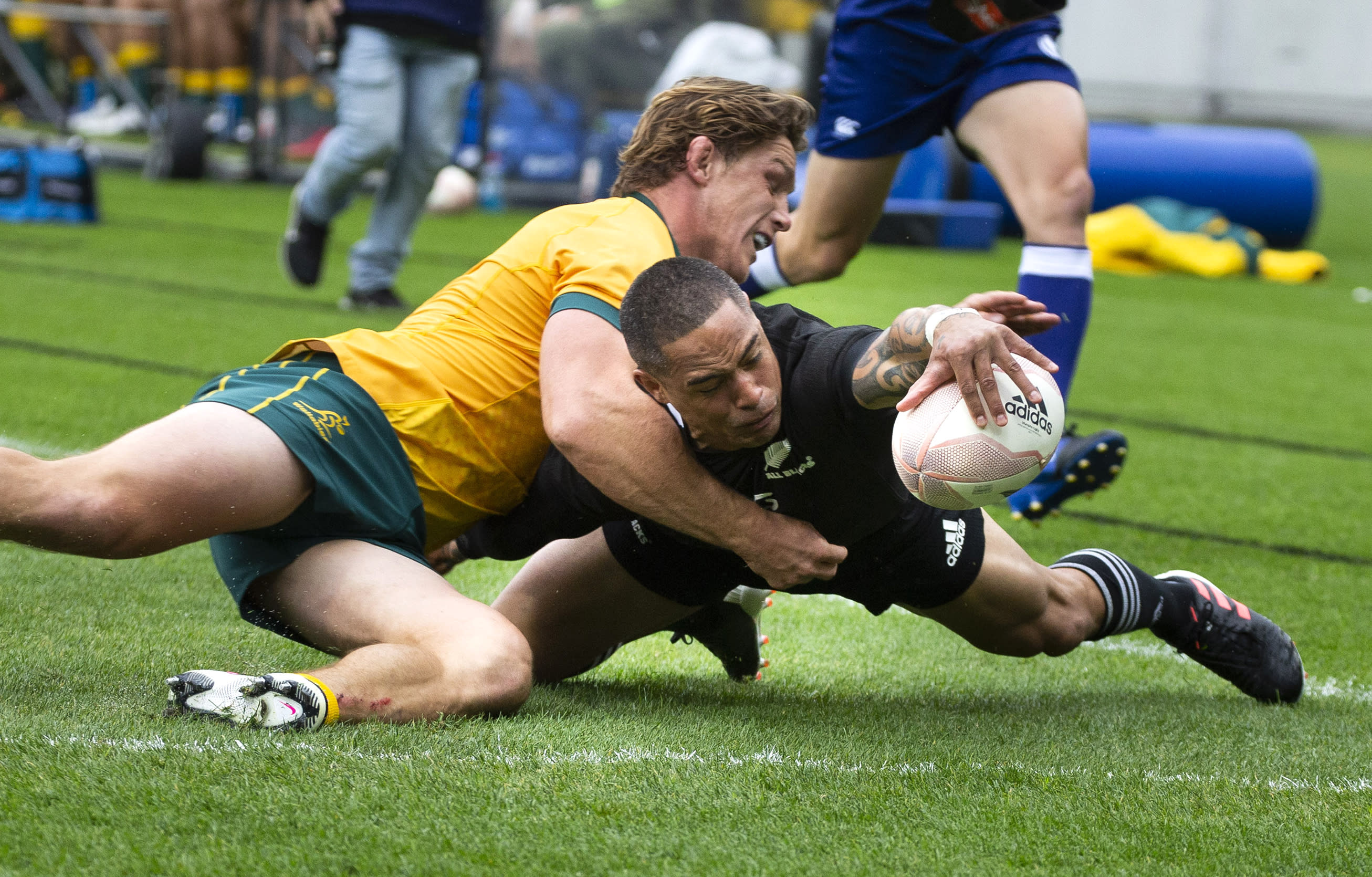 New Zealand's Aaron Smith scores a try in the tackle of Australia's Michael Hooper during the Bledisloe Cup rugby game between the All Blacks and the Wallabies in Wellington, New Zealand, Sunday, Oct.11, 2020. (Brett Phibbs/Photosport via AP)