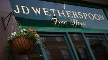 Higher costs for bar staff take shine off J D Wetherspoon's sales rise