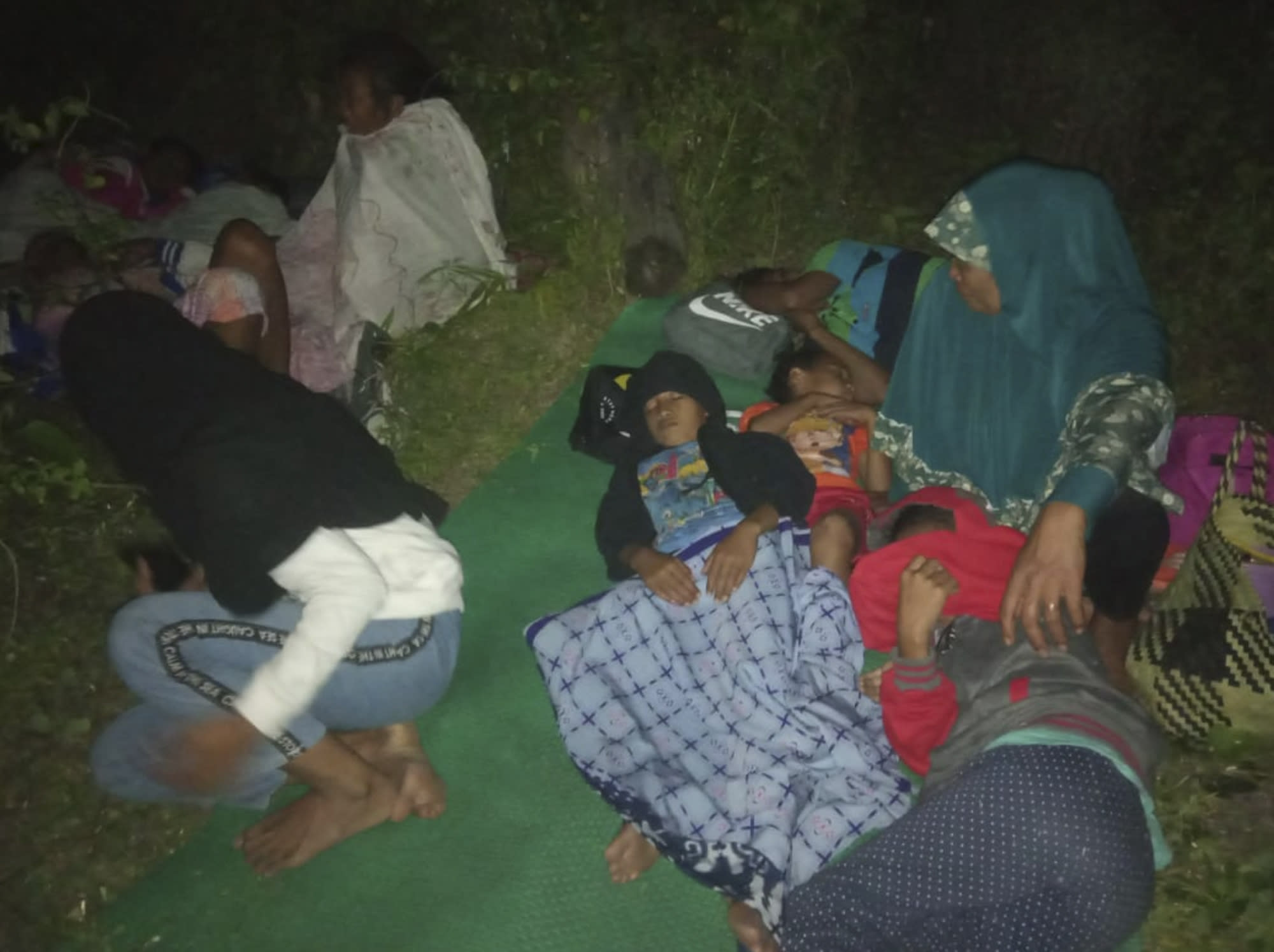 Residents sleep on the ground after leaving their homes to find higher grounds following an earthquake in Gane Utara, North Maluku, Indonesia, Sunday, July 14, 2019. A strong, shallow earthquake struck eastern Indonesia on Sunday, damaging some homes and causing panicked residents to flee to temporary shelters. There were no immediate reports of casualties, and authorities said there was no threat of a tsunami. (AP Photo)