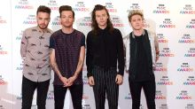 Harry Styles' One Direction bandmates have shown their support following the death of the singer's stepfather