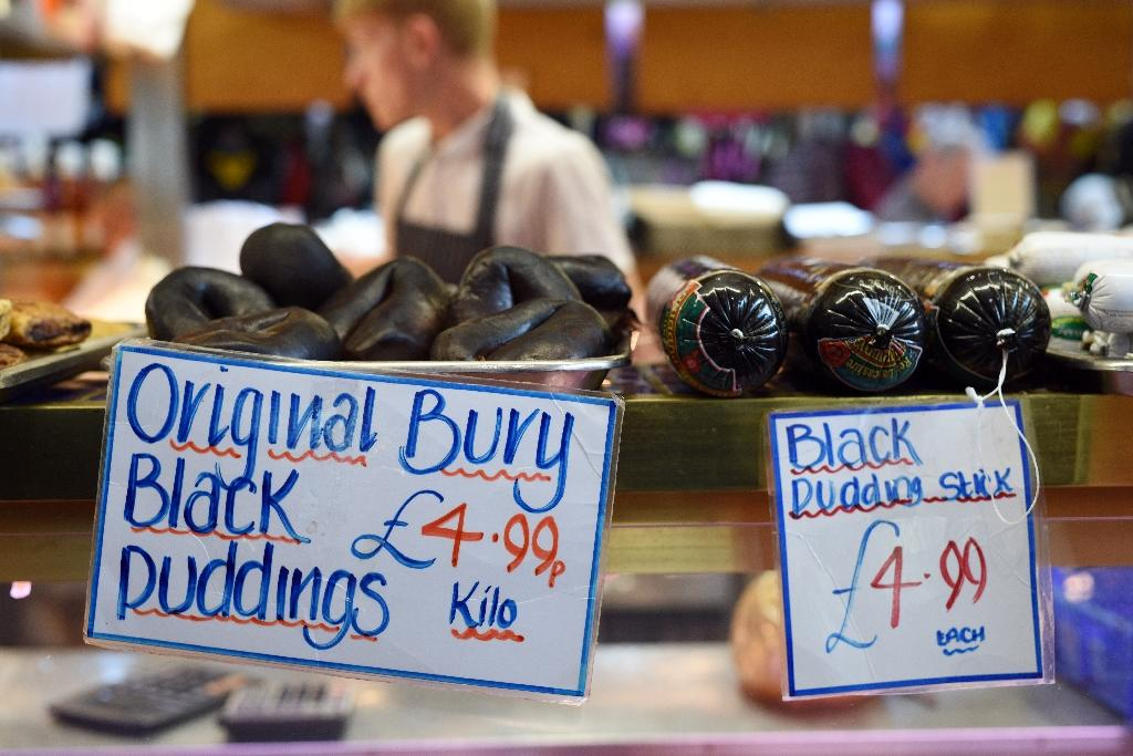 Bury black puddings for sale on a stall in the Market Hall section of Bury Market in Bury, northwest England, on August 5, 2015 (AFP Photo/Oli Scarff)