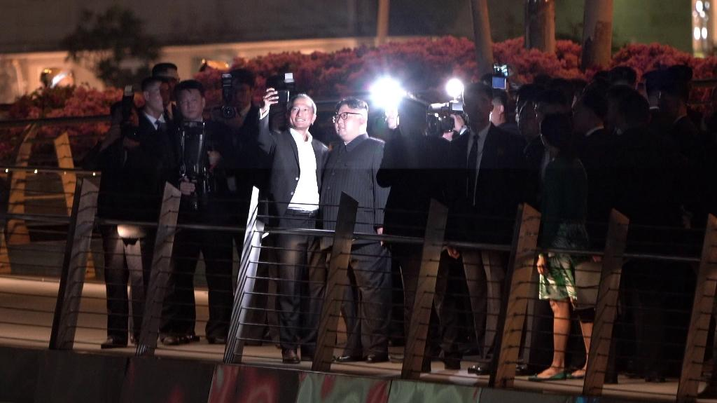 In a first, North Korean leader Kim Jong Un posed for a selfie with Singapore Foreign Minister Vivian Balakrishnan during an evening stroll through the city (AFP Photo/Nicholas Yeo)