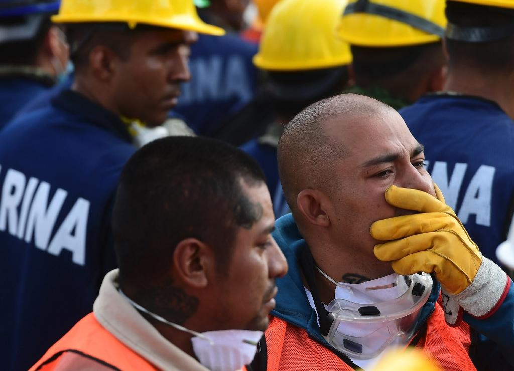 Rescue workers pictured after a seismic alert sounded in Mexico City on September 23, 2017, four days after the powerful quake that hit central Mexico
