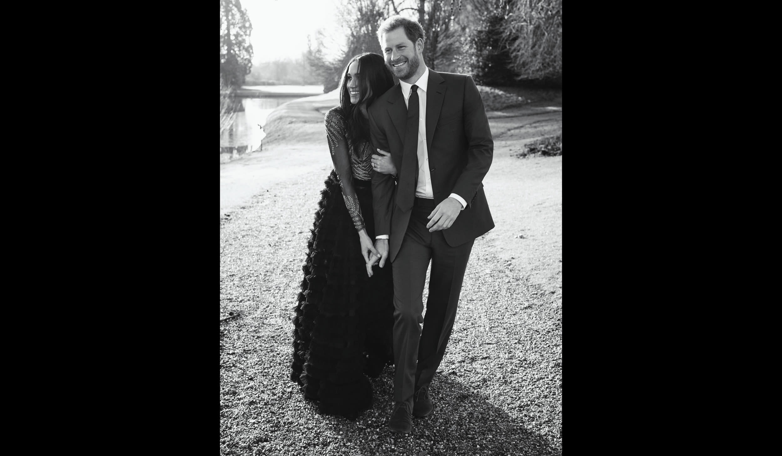 In this photo released by Kensington Palace on Thursday, Dec. 21, 2017, Britain's Prince Harry and Meghan Markle pose an official engagement photo, at Frogmore House, in Windsor, England. (Alexi Lubomirski via AP)