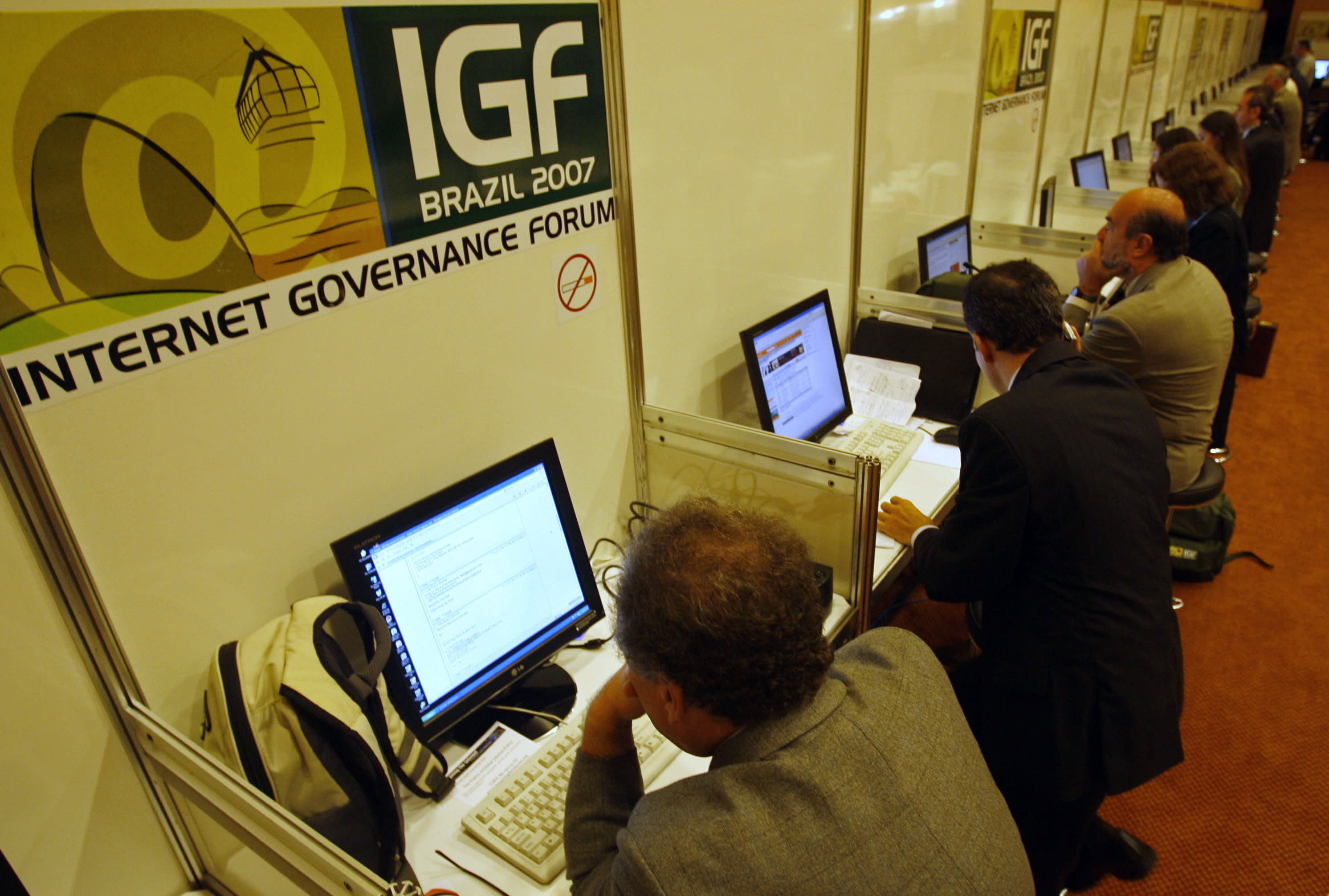 FILE - In this Nov. 12, 2007 file photo, people uses the internet during the Internet Governance Forum in Rio de Janeiro, Brazil. President Dilma Rousseff has ordered a series of measures aimed to divorce itself from the U.S.-centric Internet and at greater Brazilian online independence and security following revelations that the U.S. National Security Agency intercepted her communications, hacked into the state-owned Petrobras oil company's network and spied on Brazilians who entrust their personal data to U.S. tech companies such as Facebook and Google.(AP Photo/Ricardo Moraes, File)