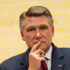 North Carolina Republican's son says warned father about operative's past