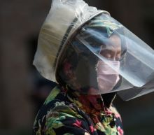 Coronavirus spreads in China prisons, Korean church as fears weigh on global markets