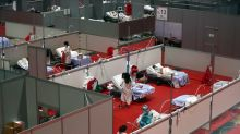 Coronavirus claims more Spanish lives, but death rate slows