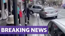 Dramatic video shows man in his 80s crash into Sydney shop