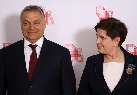 Visegrad Group (V4) member nations' Prime Ministers, Hungary's Viktor Orban and Poland's Beata Szydlo pose for a family photo during a summit in Warsaw, Poland March 28, 2017. Agencja Gazeta/Slawomir Kaminski via REUTERS
