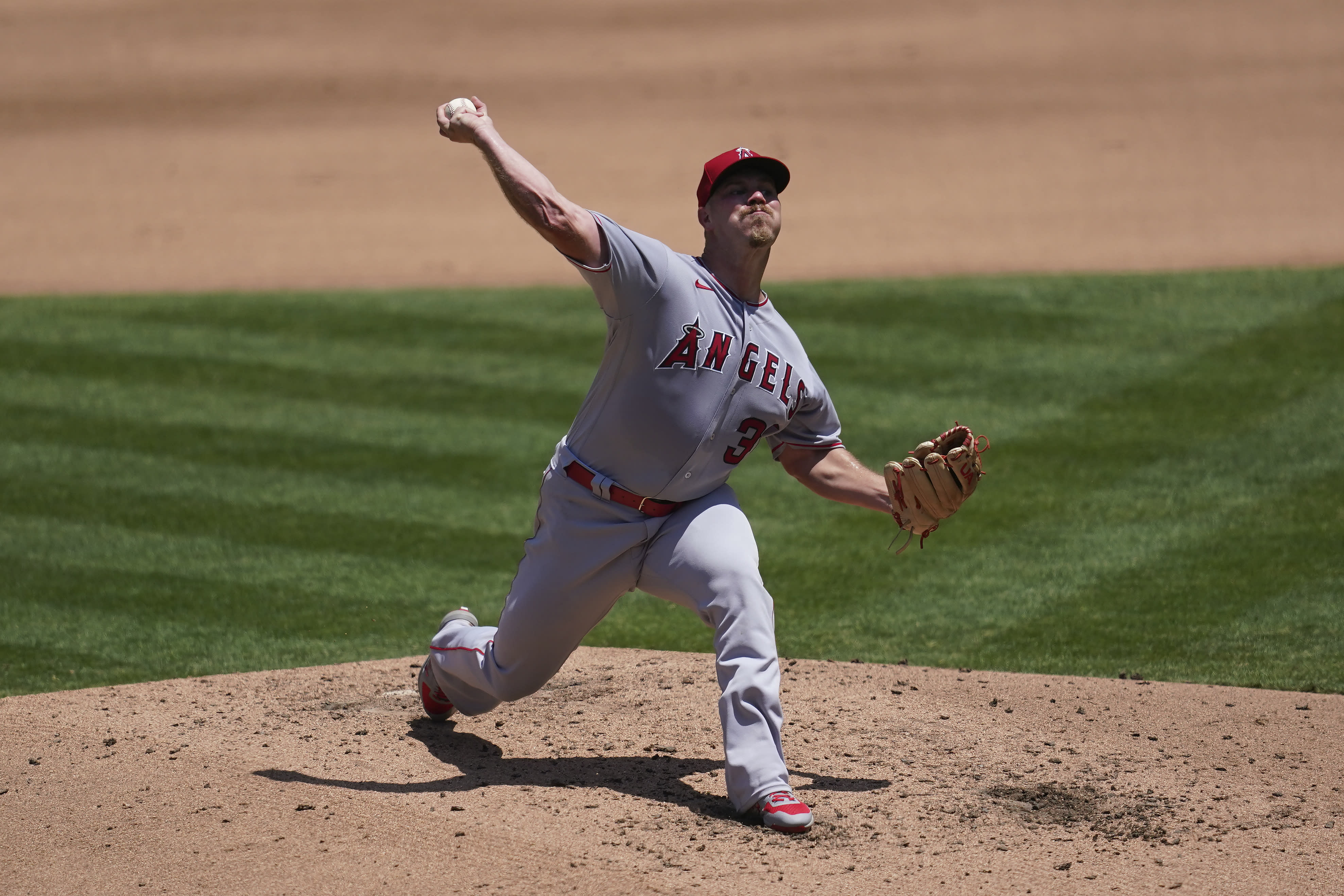 Los Angeles Angels pitcher Dylan Bundy throws against the Oakland Athletics during the fourth inning of a baseball game in Oakland, Calif., Saturday, July 25, 2020. (AP Photo/Jeff Chiu)