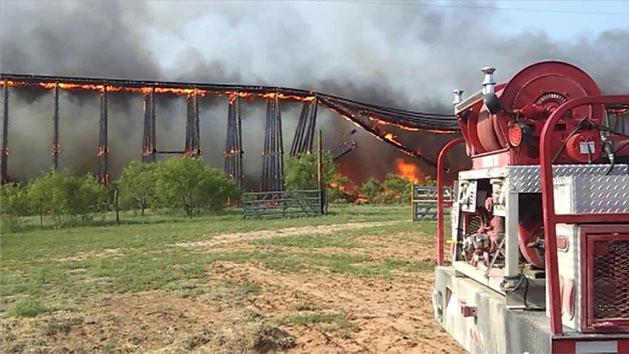 Burning railroad bridge crumples like dominoes