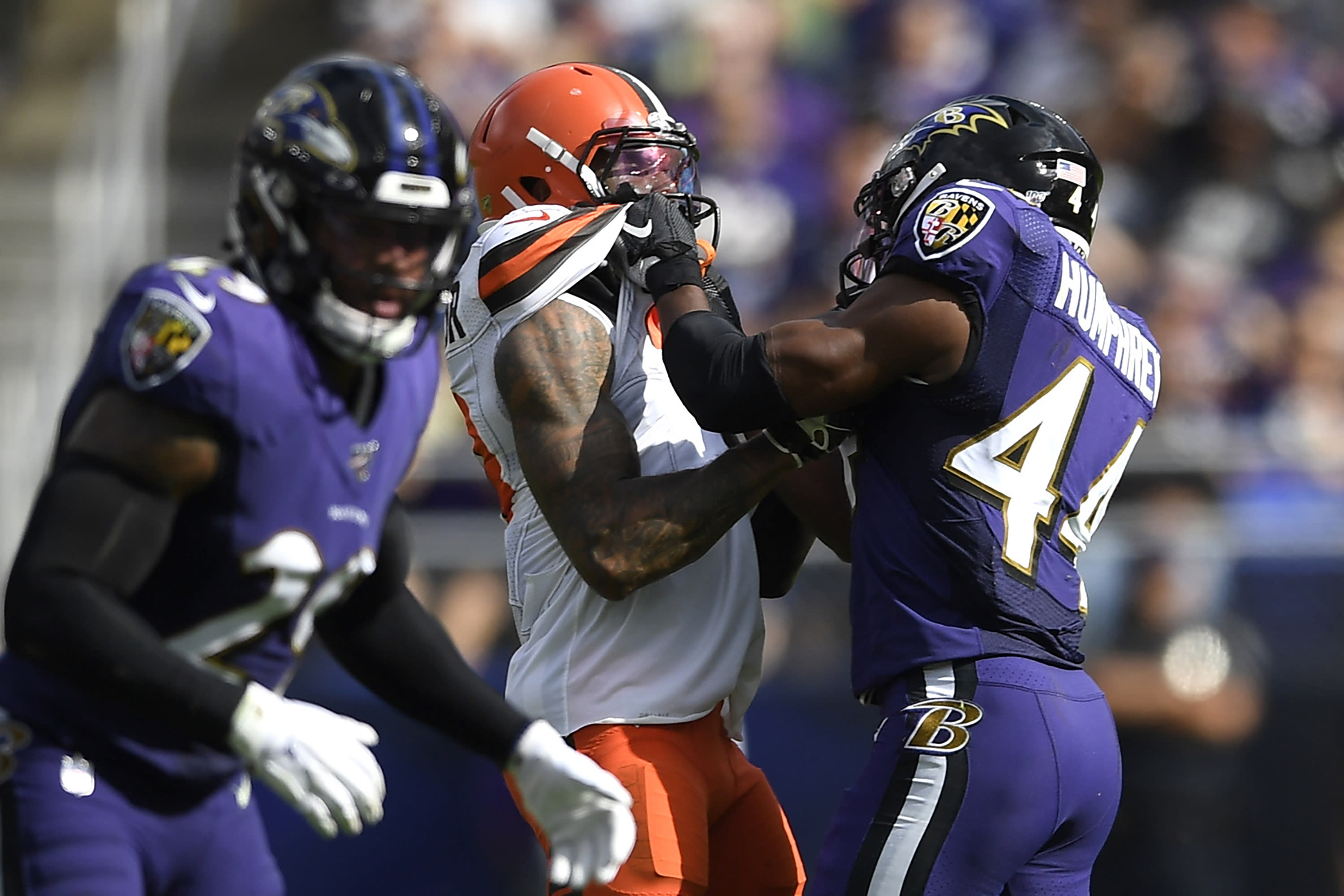 FILE - In this Sunday, Sept. 29, 2019, file photo, Cleveland Browns wide receiver Odell Beckham, center, and Baltimore Ravens cornerback Marlon Humphrey (44) grab each other during the second half of an NFL football game in Baltimore. Browns coach Freddie Kitchens wants more consistent NFL officiating after wide receiver Odell Beckham Jr. was choked during Sunday's game. Beckham got into a skirmish with Ravens cornerback Marlon Humphrey, who pinned the three-time Pro Bowler and had his hands around his neck before being pulled away. Both players were assessed personal fouls, but neither was ejected. Kitchens said he planned to reach out to the league about that situation in particular and officiating evenness in general. (AP Photo/Nick Wass, File)