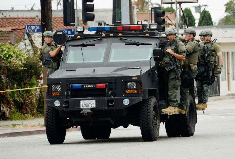 Army or police? Los Angeles police aboard an armored car in 2019 (AFP Photo/KEVORK DJANSEZIAN)